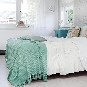 Kim Timmerman - bedrooms: teal throw, teal throw blanket, teal blanket, soft white bedding, sequined pillows, brick wall, brick accent wall, accent wall, gray brick wall, turquoise nightstand, turquoise blue nightstand,