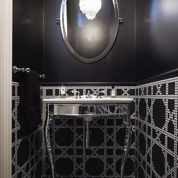 Denai Kulcsar Interiors - bathrooms - black and white tiles, lattice tiles, black and white lattice tiles, black and white powder room, powder room, black and white floor, black and white backsplash, transom window, powder room with transom window, black and white floor tiles, black and white geometric tiles, oval pivot mirror, mirrored washstand,