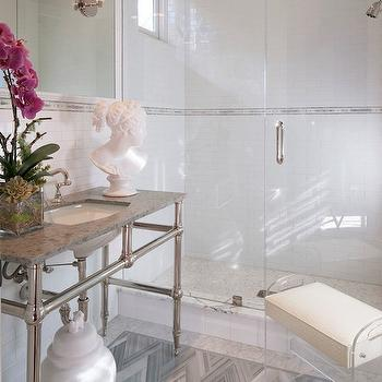 On Madison - bathrooms - lucite bench, ginger jar, white ginger jar, herringbone tiles, herringbone floor, gray herringbone tiles, gray herringbone floor, 4 leg washstand, inset mirror, walk in shower, white brick tiles,