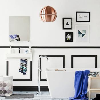 Erin Michael - bathrooms - modern freestanding tub, freestanding tub, freestanding bath, modern freestanding bath, floor mount faucet, floor mounted faucet, blue bath towel, wooden stool, black and white bathroom, white hardwood floors, hardwood floors, painted hardwood floors, gray bath mat, gray bath rug, gray and white hexagonal print basket, modern wall mount sink, modern wall mounted sink, wall mounted sink, modern faucet, square vanity mirror, frameless vanity mirror, black and white art, modern black and white art, copper pendant, copper pendant light, modern copper pendant light, white walls, white walls with black trim, white walls with black molding, white walls with black molding and trim, black and white wainscoting, bathroom waisncoting,