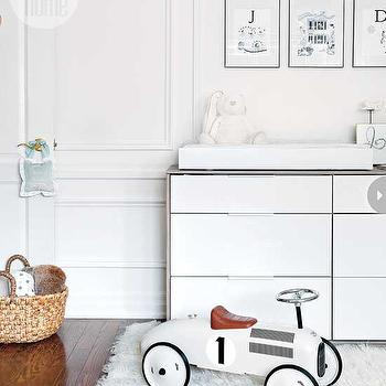 Style at Home - nurseries - hardwood floors, shag rug, white shag rug, woven basket, round woven basket, vintage style kids race car, vintage style kids ride on race car, kids ride on race car, modern white dresser, modern white dresser changing table, white changing table dresser, white dresser turned changing table, black and white nursery art, white walls, white wall color, black and white kids art, black and white nursery, white closet doors, closet door molding, door molding, ikea dresser, Nyvoll 6-Drawer Dresser, ikea dresser, white nursery, white nursery ideas, white and gray dresser, 2 tone dresser, 6 drawer dresser, Ikea Nyvoll 6-Drawer Dresser,