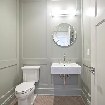 Blue Water Home Builders - bathrooms - powder room, powder room ideas, powder room sinks, powder room washstands, wall mounted sink, floating sink, gray green walls, paneled walls, paneled bathroom, paneled powder room, herringbone floor, crown moldings, powder room crown moldings, gray green moldings, base boards,
