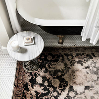 Bungalow Mag - bathrooms - black tub, black bathtub, claw foot tub, black claw foot tub, black and pink rug, bathroom rug, white marble accent table, white marble top table, vintage hex tiles, vintage hex floor, vintage hex floor, white hex tiles, white hex tile floor, white hex tile floor, white vintage hex tiles,