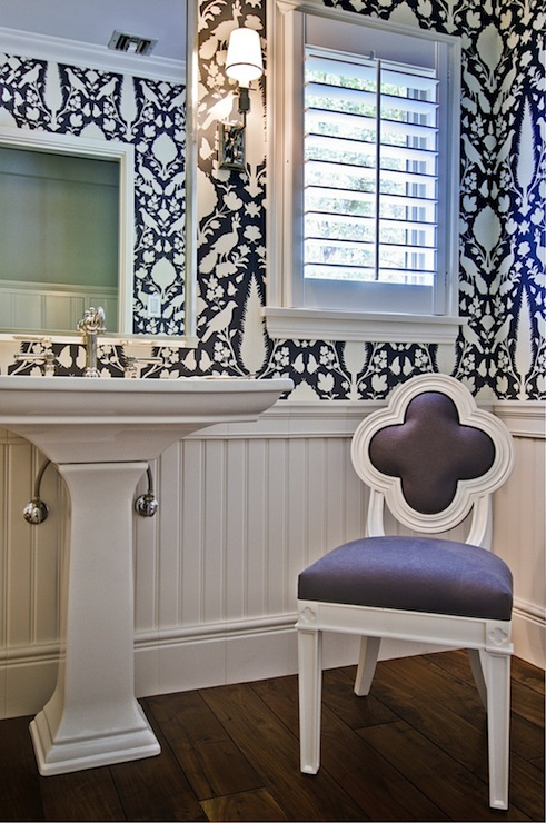 bathrooms - Chenonceau Charcoal Wallpaper, Suzanne Kasler Alexandra Side Chair, hardwood floors, powder room wallpaper, powder room wallpapered walls, beadboard, white beadboard, wood paneling, wood paneled walls, beadboard half wall, charcoal gray and white floral wallpaper, charcoal gray and white botanical wallpaper, charcoal gray and white animal wallpaper, contemporary animal print wallpaper, animals and trees wallpaper, gray and white birds and trees wallpaper, contemporary flora and fauna wallpaper, pedestal sink, silver vanity mirror, vanity mirror, plantation shutters, white shutters, window shutters, interior window shutters, gray and white chair, contemporary gray and white chair, gray and white quatrefoil chair, quatrefoil chair, contemporary quatrefoil chair, Schumacher Chenonceau Charcoal Wallpaper, powder room beadboard, quatrefoil chair, gray quatrefoil chair,