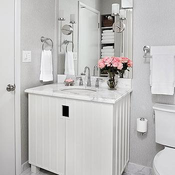 BHG - bathrooms - white and gray bath, white and gray bathroom, frameless mirror, lacquer washstand, white lacquer washstand, lacquered washstand, white lacquered washstand, white marble counter, vanity with white marble top, frameless mirror, silver wallpaper, white and gray marble tiles, white and gray marble floor,