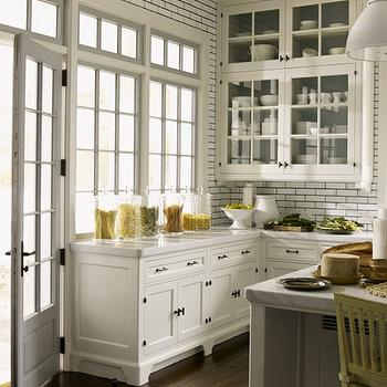 S.R. Gambrel - kitchens - glass front kitchen cabinets, creamy white cabinets, creamy white kitchen cabinets, white marble countertops, ceiling height backsplash, ceiling height kitchen backsplash, ceiling height subway tiles, subway tile with black grout,