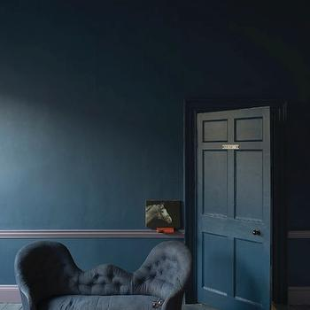 Farrow and Ball - living rooms - dark blue walls, dark blue wall color, blue walls, blue wall color, gray trim, gray baseboards, gray chair rail, gray hardwood floors, hardwood floors, unfinished hardwood floors, chaise, blue chaise, blue tufted chaise, traditional tufted blue chaise, dark blue paint colors, dark blue paint colors,