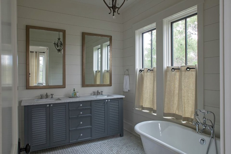 Geoff Chick - bathrooms - shiplap paneled walls, shiplap paneling, shiplap, bathroom shiplap, marble mosaic tiled floor, marble mosaic floor tile, freestanding tub, freestanding bath, traditional faucet, dual vanity, gray dual vanity, wood framed vanity mirror, wood vanity mirror, louvered vanity, louvered bathroom vanity, gray louvered bathroom vanity, gray bathroom vanity, white hardware, his and hers sink, dual sinks, master bath, towel ring, cafe curtain, linen cafe curtain, cafe curtains in bathroom, black framed window, steel framed window, marble counter, marble countertop, wood paneled walls, wood paneling, painted wood paneling, louvered washstand, louvered double vanity, grommet cafe curtains, linen cafe curtains,
