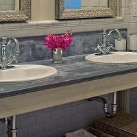 Gorgeous bathroom with dual oval shaped sinks with traditional style faucets ...