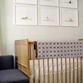 Project Nursery - nurseries - gray walls, gray wall color, gender neutral nursery, wood crib, wooden crib, white crib bedding, beige and white striped crib bedding, brown and white geometric throw, geometric throw, framed animal photos, framed baby animal photos, framed baby animal photography, baby animal art, Sharon Montrose The Animal Print Shop, nursery art, nursery art ideas, art over crib, art above crib, striped crib skirt, The Animal Print Shop,