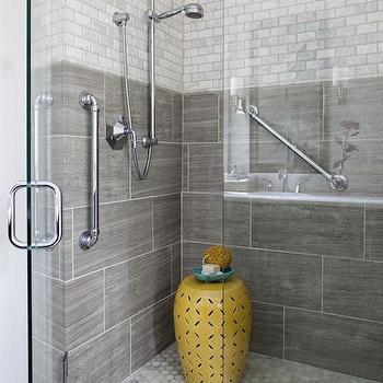 Erin Glennon Interiors - bathrooms - gray tile, oversize gray tile, gray bathroom tile, large scale gray tile, gray tiled shower surround, marble tile, marble subway tile, carrera marble subway tile, carrera marble subway tiled shower surround, walk-in shower, seamless glass shower door, frameless glass shower door, adjustable shower head, shower hand rails, carrera marble, carrera marble hex floor tile, carrera marble hex tiled floor, carrera marble hex shower floor, marble hex floor tile, marble hex tile, yellow garden stool, pierced yellow garden stool, carrera marble tile, gray shower tiles, yellow and gray shower, gray shower surround, stool in shower, shower stool, yellow lattice stool, carrera hex tiles, carrera hex shower floor,