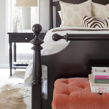 Erin Glennon Interiors - bedrooms - black bed, black framed bed, black turned wood bed, black turned leg bed, black nightstand, black single drawer nightstand, black one drawer nightstand, white lamp, white faux bamboo lamp, gray walls, gray wall color, woven window shade, woven window blind, cowhide, brown and white cowhide, rug over carpet, rug on carpet, rug layered over carpet, wall to wall carpet, carpeting, carpet, white bedding, white bed linens, white duvet, paisley pillow, zebra print pillow, brown and white zebra print pillow, coral velvet tufted bench, tufted velvet bench, stacked books, bench at end of bed, bench at foot of bed, coral bench, coral velvet bench, coral tufted bench,
