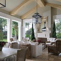 French inspired sunroom features exposed wood beams on vaulted ceiling painted ...