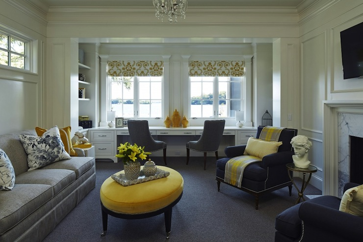 Martha O'Hara Interiors - living rooms - yellow and gray room, yellow and gray living room, fireplace, white fireplace, marble surround, marble fireplace surround, tall ceilings, crown molding, wall moldings, gray carpet, wall to wall carpet, gray carpeting, gray desk chairs, built-in desk, built-in desk under window, built-in desk below window, yellow ginger jars, yellow and white striped pillow, gray and white floral pillow, gray sofa, skirted gray sofa, tv over mantle, tv over fireplace, flat screen over fireplace, yellow velvet ottoman, oval shaped yellow velvet ottoman, tray, vase of flowers, yellow lilies, gray and yellow plaid throw, navy blue armchair, navy blue nailhead trim armchair, gold side table, bust, gray barrel back chair, yellow and white roman shade, yellow and white floral roman shade, yellow and gray family room, built in bookcase, built in desk, desk for 2, navy blue chairs, yellow and gray throw, yellow and gray throw blanket, yellow ottoman, oval yellow ottoman, yellow oval ottoman, gray velvet sofa,
