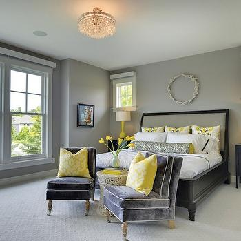 Martha O'Hara Interiors - bedrooms - white wreath, wreath over headboard, black bed with gray headboard, black bed frame with gray headboard, black nightstand, black bedside table, black three drawer nightstand, yellow table lamp, matching nightstands, windows flanking bed, windows next to bed, tall yellow lamp, black hotel bedding, black yellow and white pillow, black yellow and white euro sham, black yellow and white bolster pillow, white bedding, white bed linens, white sheets, gray velvet slipper chair, gray velvet armless chair, gray velvet armless chair with white piping, gray velvet slipper chair with white piping, yellow and white damask pillow, white contemporary stool, vase of flowers, yellow lilies, sash windows, gray walls, gray wall color, ivory carpet, cream carpet, wall to wall carpet, wall to wall carpeting, gray and yellow bedroom, semi flush mount crystal pendant, semi flush mount pendant, gray and yellow bedroom, black and yellow bedroom, yellow black gray bedroom, yellow gray black bedroom, antler wreath, white antler wreath, bedroom chairs, gray slipper chairs, gray velvet slipper chairs, yellow and black bolster pillow,