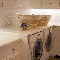 Giannetti Home - laundry/mud rooms - laundry room, clothes rod, built in clothes rod, laundry room clothes rod, beveled subway tiles, beveled subway tile backsplash, beveled subway backsplash, white marble countertops,