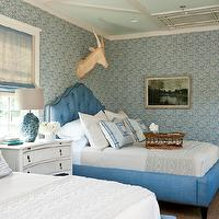 Southern Living - girl's rooms - bedroom wallpaper, white and blue wallpaper, blue wallpaper, blue patterned wallpaper, mirror, greek key chest, distressed chest, blue glass lamp, bound sisal rug, blue roman shade, mitered pillows, blue mitered pillow, shared nightstand, curved nightstand, curved chest, white curved chest, turquoise lamp, turquoise blue lamp, turquoise tiled lamp, blue roman shade, linen roman shade, blue linen roman shade, blue beds, blue tufted bed, blue linen bed, shared kids room, shared kids bedroom, shared girls room,