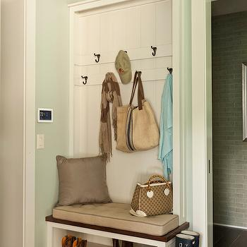Southern Living - laundry/mud rooms - Sherwin Williams - Comfort Gray - mudroom, mudroom, gray green walls, gray green paint colors, green gray walls, green gray paint colors, comfort gray, sherwin williams paint colors, paneled walls, built in coat rack, coat rack, built in bench, mudroom bench, builtin shoe shelf, built in shoe rack, mudroom ideas, mudroom design,