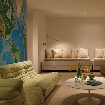 Heliotrope Architects - basements - playroom, play room, basement playroom, basement play room, world map, world map accent wall, floor cushions, green floor cushion, tufted floor cushions, lounge chairs, tufted lounge chairs,