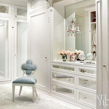 Atlanta Homes & Lifestyles - closets - walk-in closet, walk-in wardrobe, built-in closets, closet system, custom closet, dressing room, mirror fronted closet doors, mirrored closet doors, mirror fronted dresser drawers, mirrored dresser drawers, nickel hardware, ivory carpet, blue and white quatrefoil chair, quatrefoil chair, vase of flowers, inset mirror, built-in mirror, mirrored closet, floor to ceiling closets, pink crystal wall sconce, mirror paneled closet doors, Suzanne Kasler Alexandra Side Chair, mirrored doors, mirrored closet doors, mirrored dresser, quatrefoil chair, blue quatrefoil chair, elegant dressing rooms, dressing roon, Alexandra Side Chair,