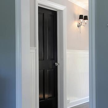 Kelly Baron - entrances/foyers - gray walls, gray wall color, hardwood floors, dark hardwood floors, black door, black, interior doors, crystal door knob, beadboard, white beadboard, beadboard wainscoting, greige walls, greige wall color, polished nickel sconce, two arm polished nickel sconce, polished nickel sconce with black shade, hallway beadboard,