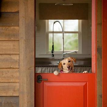 The Design Atelier - entrances/foyers - wood siding, red dutch door, dutch door, bright red dutch door, kitchen dutch door, dog,  Red Dutch door