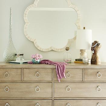 Karen B Wolf Interiors - bedrooms: 8 drawer dresser, made goods mirror, decorative bust, alabaster lamp,  Chic bedroom features Made Goods Fiona