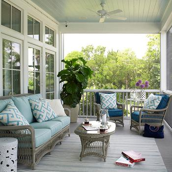 Coastal Living - porches - screen porch, screen in porch, blue ceiling, beadboard ceiling, blue beadboard ceiling, piazza blue, porch ceiling fan, fiddle leaf fig, gray wicker furniture, gray wicker sofa, gray wicker chairs, turquoise cushions, deep blue cushions, fretwork pillow, turquoise fretwork pillows, oval coffee table, wicker coffee table, gray wicker coffee table, glass top coffee table, dash and albert rug, striped rug, blue striped rug, outdoor rug, outdoor striped rug, , Dash and Albert Rugby Stripe Light Blue Indoor/Outdoor Rug,