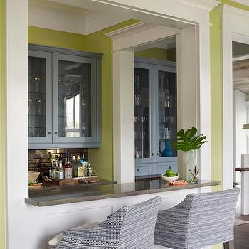 Coastal Living - living rooms - living room bar, bar ideas, green walls, green paint colors, glass front cabinets, blue cabinets, painted cabinets, brick tile backsplash, granite counters, granite countertops, verde wild sea granite, verde wild sea granite counters, verde wild sea granite countertops, Sherwin Williams Hearts of Palm,