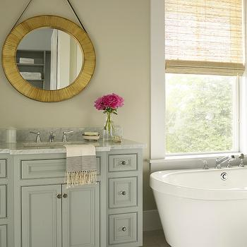 Coastal Living - bathrooms - Sherwin Williams - Mineral Deposit - gray tiles, gray staggered tiles, tan walls, tan paint colors, brass mirror, round brass mirror, gray washstand, gray vanity, gray bath vanity, gray bathroom vanity, painted vanity, painted washstand, white carrera extra marble, white carrera extra marble countertop, freestanding bathtub, bathtub under window, tub under window, oval bathtub,