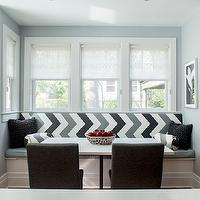 Karen B Wolf Interiors - dining rooms - banquette under window, built in banquette, dining nook, built in dining banquette, chevron banquette, chevron cushions, banquette cushions, dining banquette cushions, black and gray chevron cushions, dark gray dining chairs, chevron bolster pillows, dining banquette under window, dining nook ideas,