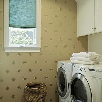 Jenn Feldman Designs - laundry/mud rooms - gold wallpaper, gold wallcovering, gold star wallpaper, teal roman shade, gray tiles gray staggered tiles, cabinets over washer and dryer, front load washer and dryer,