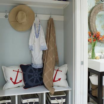 Rachel Reider Interiors - laundry/mud rooms - blue and gray hex tiled floors, blue and gray hexagonal floor tile, hex floor tile, hex tiled floors, hexagonal floor tile, mudroom bench, built-in bench, built-in mud room bench, black and white canvas baskets, red and white anchor pillow, navy blue ships wheel pillow, blue gray walls, blue gray wall color, coat hooks, mudroom coat hooks, mud room coat hooks, floating shelf, white floating shelf, mudroom storage, mud room storage, mudroom storage bench, mud room storage bench, mud room cubbies, mudroom cubbies, coastal mudroom,