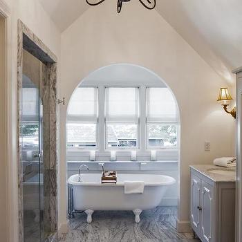 bathrooms - white and gray bath, white and gray bathroom, gray bath, gray bathroom, french bath, french bathroom, french washstand, gray french washstand, french vanity, gray french vanity, french bath vanity, french bathroom vanity, white and grey marble, white and grey marble countertop, marble floor, cathedral ceiling, bathroom cathedral ceiling, bathroom with cathedral ceiling, cathedral ceiling in bathroom, bathtub alcove, bath alcove, bathtub nook, bath nook, claw foot bathtub, iron chandelier, master bath chandelier, glass walk in shower, gray marble surround,