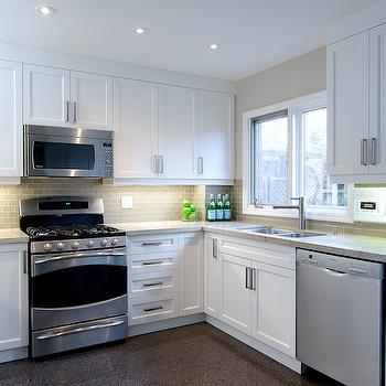 Emily Hollis Interior Design - kitchens: above the range microwave, over the range microwave, white cabinets, white kitchen cabinets, glass subway tiles, mini glass subway tiles, mini subway tiles, mini glass tiles, gray glass tiles, gray glass backsplash, dual kitchen sink,