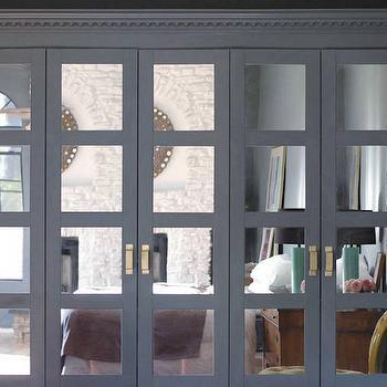 Little Green Notebook - closets - Benjamin Moore - Knoxville Gray - ikea wardrobe, ikea pax, ikea pax system, pax system, pax wardrobe, ikea doors, ikea closet, ikea closet doors, ikea wardrobe door, bergbo doors, ikea closet system, gray wardrobe, gray wardrobe cabinets, gray closet cabinets, mirrored doors, closet with mirrored doors wardrobe with mirrored doors, chunky hardware, gold hardware, gold handles, spray painted hardware, wardrobe moldings, cabinet moldings, gray moldings, dentil moldings, blue gray walls, blue gray paint colors,