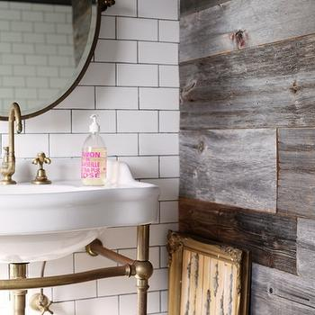 bathrooms: plank wall, planked wall, bathroom accent wall, bath accent wall, bathroom with accent wall, accent wall in bathroom, rustic plank wall, brass pivot mirror, round pivot mirror, 2 leg washstand, brass washstand, brass 2 leg washstand, 2 leg brass washstand, brass sink console, 2 leg sink console, brass faucet, brass gooseneck faucet, gold baroque frames,