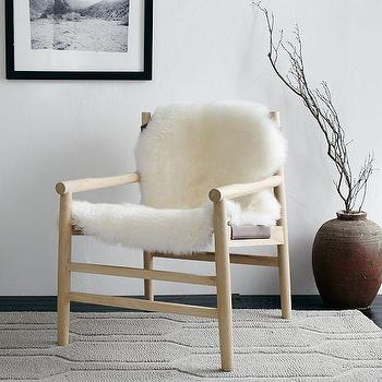 Seating - Leather + Fur Sling Chair | west elm - wood framed leather and fur chair, wood framed leather sheepskin chair, wood framed leather chair draped in sheepskin,