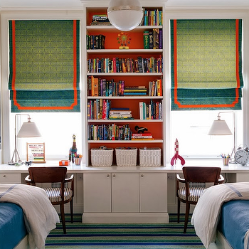 Trevor Tondro - boy's rooms - built-ins, built-ins flanking windows, built-ins framing windows, built-in bookcase between windows, built-in bookshelves between windows, striped carpet, striped blue and green carpet, white storage bed, storage bed, twin beds, blue bedding, blue coverlet, blue hotel bedding, vintage chair, vintage desk chair, wooden desk chair, built-in desk, built-in workstation, desk lamp, modern desk lamp, orange backed shelves, orange backed bookcase, orange backed bookshelves, orange backed shelving, roman shades, teal green roman shade, teal green window shades, teal roman shade with orange trim, teal roman shade with orange border, teal and orange roman shade, nickel and opal glass pendant, hicks pendant, kids desks, boys desk, shared desk, long desk, kids long desk,
