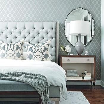 Chatelaine - bedrooms - blue and gray room, blue and gray bedroom, trellis wallpaper, gray trellis wallpaper, accent wall, bedroom accent wall, wallpaper accent wall, wallpapered accent wall, blue velvet bed, blue velvet headboard, blue tufted bed, blue tufted headboard, ivory and blue pillows, white and blue bedding, bed at foot of bed, bedroom bench, blue velvet bench, rug under bed, 2 tone nightstand, gray lamp, gray table lamp, mirror over nightstand, mirror above nightstand, blue knit throw, elegant bedroom, serene bedroom,