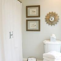 Beach Glass Interior Designs - bathrooms - gray walls, gray paint colors, gray bathroom walls, bathroom with gray walls, gray walls in bathroom, gray bathroom paint, edgecomb gray, monogrammed shower curtain, small sunburst mirror, mirror over toilet,
