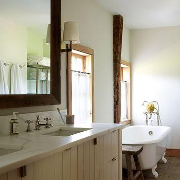 Oak Hill Architects - bathrooms - farmhouse bath, farmhouse bathroom, rustic wood floor, wide plank floor, rustic wide plank floor, clawfoot tub, clawfoot bathtub, sawhorse stools, cream double washstand, his and her sinks, wood beveled mirror, beveled wood mirror,