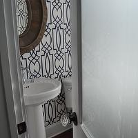 JacksonBuilt Custom Homes - bathrooms - trellis wallpaper, navy trellis wallpaper, navy blue trellis wallpaper, wood mirror, pedestal sink, rounded pedestal sink, frosted glass door, powder room wallpaper, dolce vita wallpaper, Dolce Vita Wallpaper, Pieced Oval Mirror,