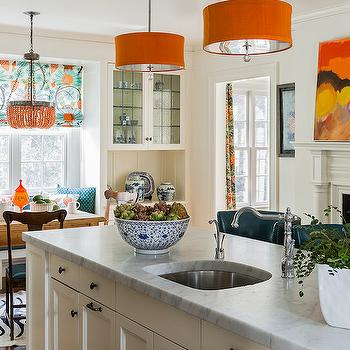 Katie Rosenfeld Design - kitchens - off white island, off white kitchen island, off white center island, orange pendants, orange light pendants, orange chandeliers, orange drum pendant, long kitchen island, white marble counter, white marble countertop, island prep sink, island sink, offset faucet,