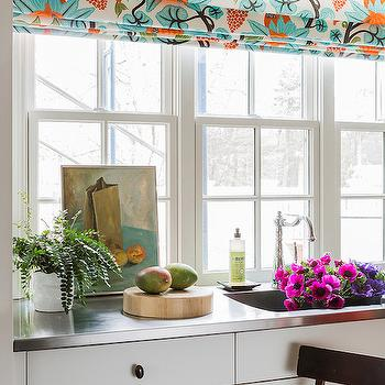 Katie Rosenfeld Design - kitchens - oil rubbed bronze hardware, orb pulls, orb hardware, white cabinets, stainless steel countertop, modern floral roman shade, blue and orange roman shade,