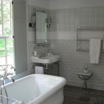 Talk of The House - bathrooms - gray bathroom, gray tiles, gray bathroom tiles, gray grid tiles, gray backsplash, gray tiles backsplash, gray subway tiles, gray subway tile backsplash, pencil rail, mini subway tiles, beveled subway tiles, mini beveled subway tiles, beveled mini subway tiles, rectangular mirror, mirror with shelf, vintage glass shelf, 2 leg washstand, wall towel warmer, towel warmer, white marble table, marble accent table, bathroom table, bathroom accent table, gray shutters, freestanding bathtub, floor tub filler, floor bathtub filler, wood floors, window shutters, gray window shutters, bathtub under window, bathtub below window,