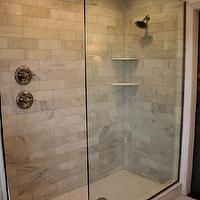 bathrooms - glass shower, walk in shower, walk in shower ideas, carrera marble, carrera marble shower, carrera marble shower tiles, carrera marble shower surround, carrera marble tile shower, shower shelves, corner shower shelves, rain shower head, shower floor, hex tile shower floor, hex shower floor, white hex shower floor,