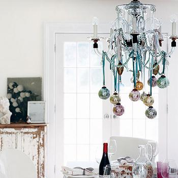 Domino Magazine - dining rooms - chandelier ornaments, disco ball ornaments, lucite chandelier, ghost chair, white ghost chair,  Lovely dining