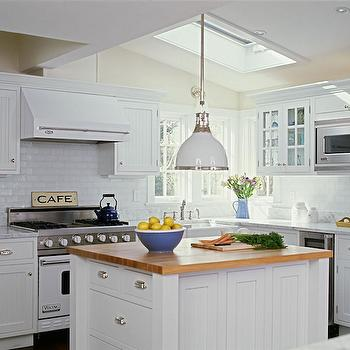 Smith River KItchens - kitchens - vaulted ceilings, vaulted kitchen ceiling, skylight, corner kitchen window, white cabinets, white cabinetry, white kitchen cabinets, white kitchen cabinetry, white beadboard cabinets, white beadboard cabinetry, beadboard cabinets, beadboard cabinetry, polished nickel hardware, cup pull hardware, marble counters, marble countertops, butcher block counters, butcher block countertops, white oven, white range, white stove, white viking oven, white viking range, white viking stove, white oven hood, viking oven hood, white viking oven hood, beverage fridge, stainless steel microwave, built-in microwave, glass fronted cabinets, glass front cabinets, white and polished nickel pendant, white enamel and polished nickel pendant, kitchen island, farm sink, farmhouse sink, apron sink, white beadboard kitchen cabinets, kitchen beadboard, beadboard island, white beadboard island, 2 tone counters, light butcher block countertops,