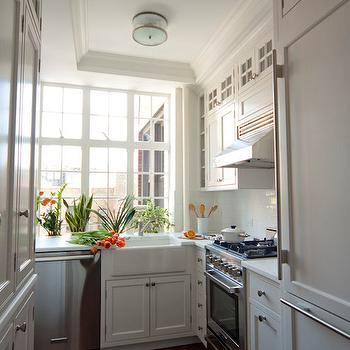 Smith River KItchens - kitchens - white cabinets, white cabinetry, white kitchen cabinets, white kitchen cabinetry, nickel hardware, white counters, white countertops, farm sink, farmhouse sink, apron sink, stainless steel appliances, stainless steel dishwasher, stainless steel oven, stainless steel range, stainless steel stove, stainless steel oven hood, oven hood, hidden fridge, concealed fridge, cabinet fronted fridge, cabinet fronted refrigerator, freezer drawers, paneled fridge, paneled refrigerator, paneled freezer drawers, white subway tile, subway tiled backsplash, subway tile, glass fronted cabinets, glass front accent cabinets, glass fronted accent cabinets, crown molding, ceiling height cabinets, ceiling height cabinetry, flush mount pendant, ceiling mount pendant, tray ceiling, kitchen tray ceiling, tiny kitchen, small kitchen, tray ceiling, kitchen tray ceiling, glass front kitchen cabinets,